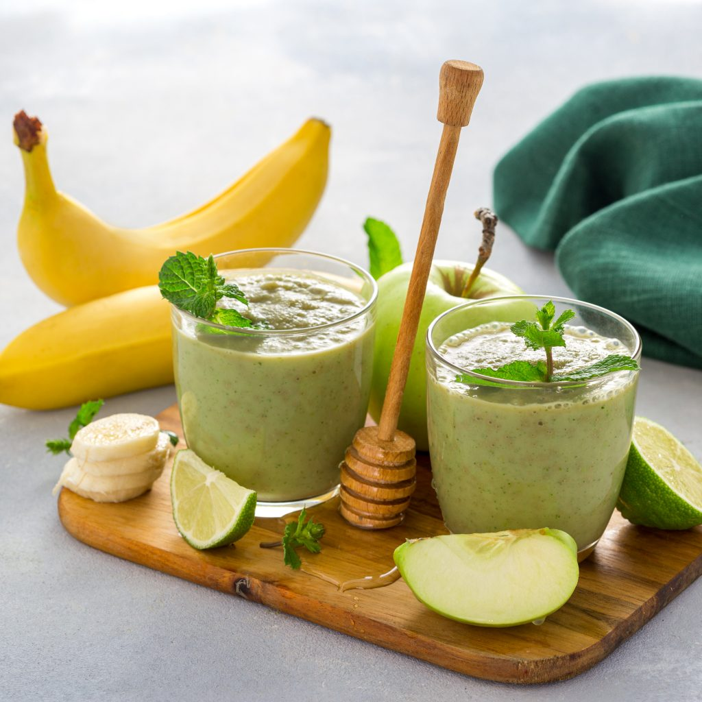 Weight loss clean eating healthy dieting food Green smoothie drink detox of apple banana lime
